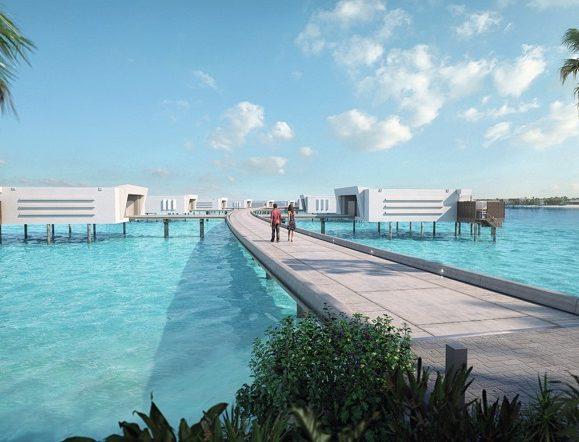 Laufsteg, an dem sich die Zimmer über dem Meer des Hotels Riu Palace Maldivas