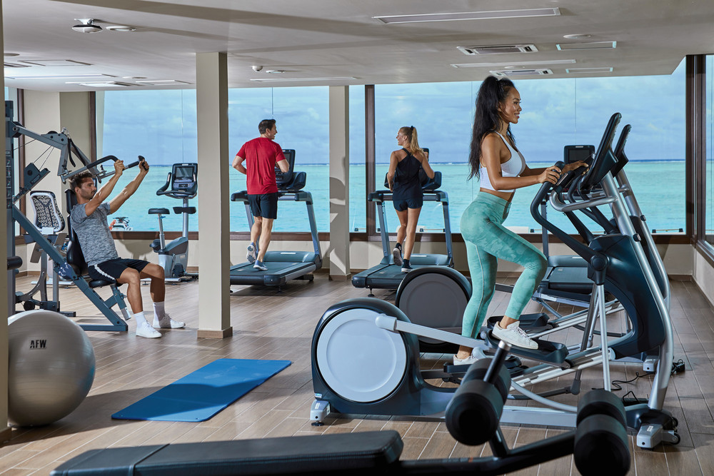 You can look out onto the waters of the Maldives from the hotel gym