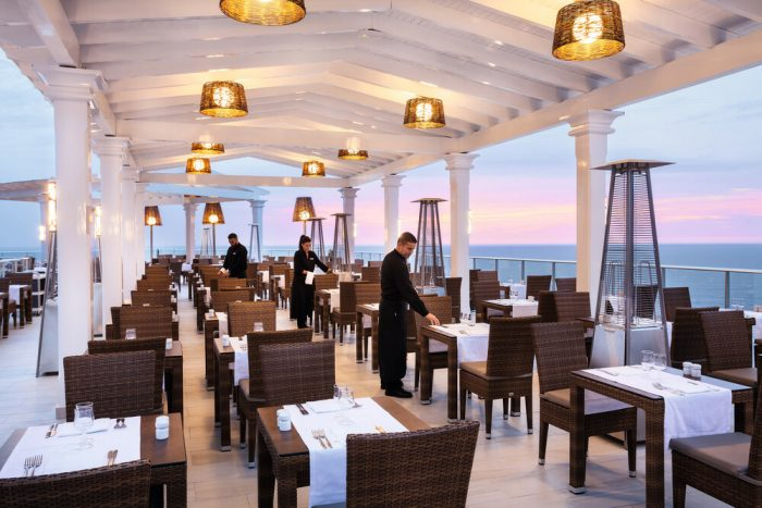Enjoy the terrace of the Riu Vistamar hotel's main restaurant