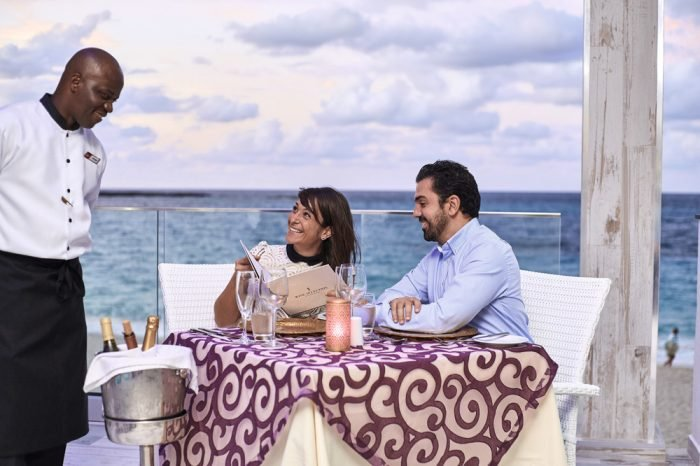 Enjoy a romantic meal with your partner in the Bahamas