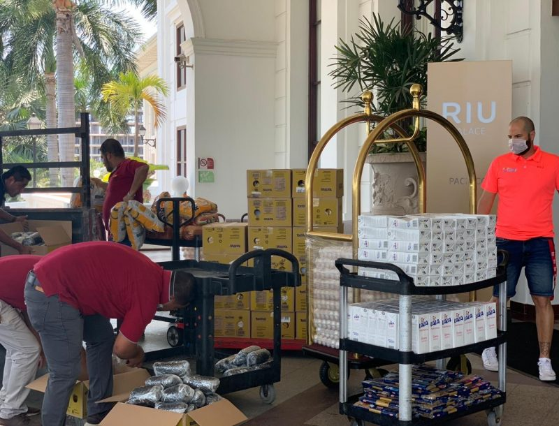 Employees at the Riu Palace Pacífico hotel in Mexico collect food to donate to social organisations