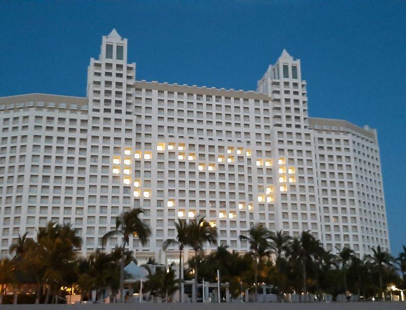 The façade of the Riu Emerald Bay hotel illuminated due to the fight against the coronavirus